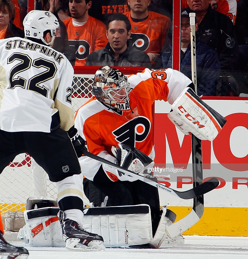 Goalie Steve Mason #35 of the Philadelphia Flyers makes a save on a shot by Lee Stempniak #22 of the Pittsburgh Penguins during the second period of an NHL hockey game at Wells Fargo Center on March 15, 2014 in Philadelphia, Pennsylvania.