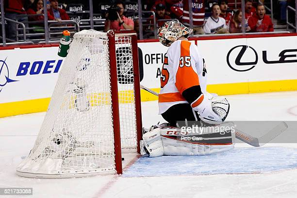 Goalie Steve Mason of the Philadelphia Flyers reacts after giving up the second goal to the Washington Capitals in the second period of Game Two of...