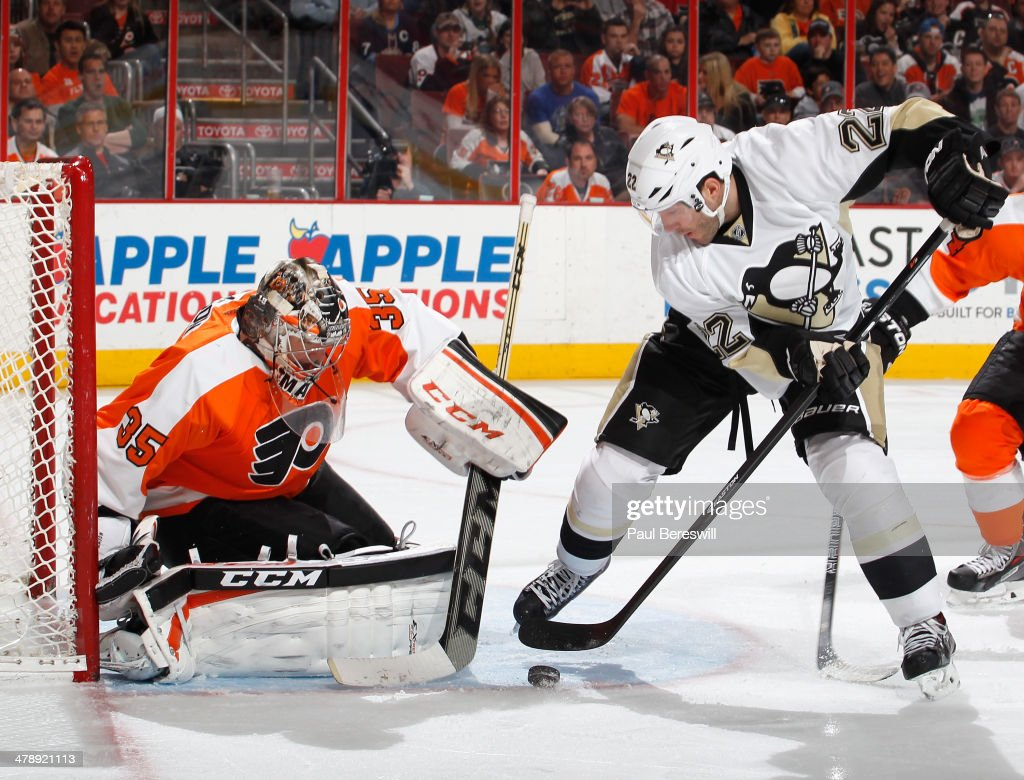 Goalie Steve Mason #35 of the Philadelphia Flyers stops a breakaway shot by Lee Stempniak #22 of the Pittsburgh Penguins in the third period of an NHL hockey game at Wells Fargo Center on March 15, 2014 in Philadelphia, Pennsylvania.