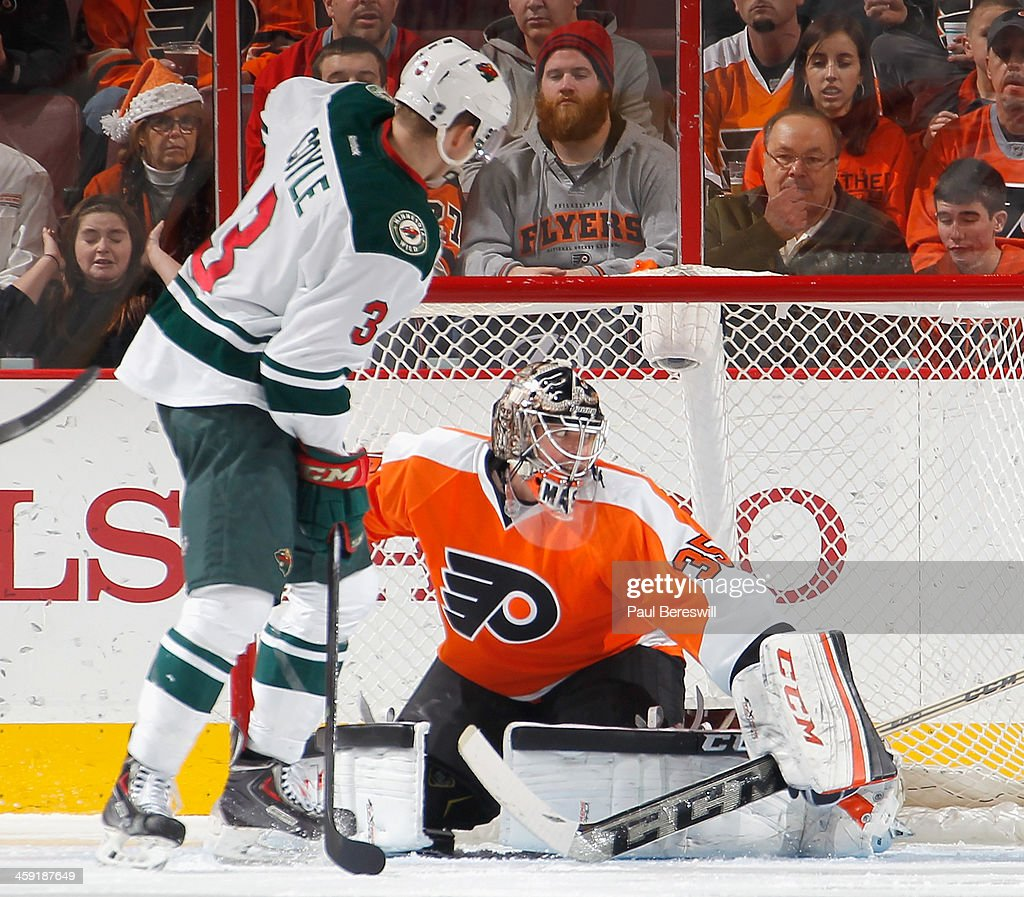 Goalie Steve Mason #35 of the Philadelphia Flyers stops a shot by <a gi-track='captionPersonalityLinkClicked' href=/galleries/search?phrase=Charlie+Coyle&family=editorial&specificpeople=7029381 ng-click='$event.stopPropagation()'>Charlie Coyle</a> #3 of the Minnesota Wild in the second period of an NHL hockey game at Wells Fargo Center on December 23, 2013 in Philadelphia, Pennsylvania.