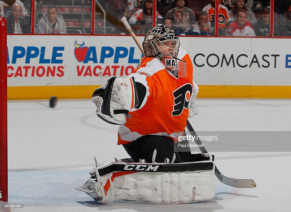 Goalie Steve Mason #35 of the Philadelphia Flyers tips the puck off net for a save in the third period of an NHL hockey game against the Washington Capitals at Wells Fargo Center on December 17, 2013 in Philadelphia, Pennsylvania.