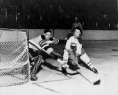 Goalie Terry Sawchuk of the Boston Bruins blocks a shot by Jean Beliveau of the Montreal Canadiens on March 11 1956 at the Boston Garden in Boston...