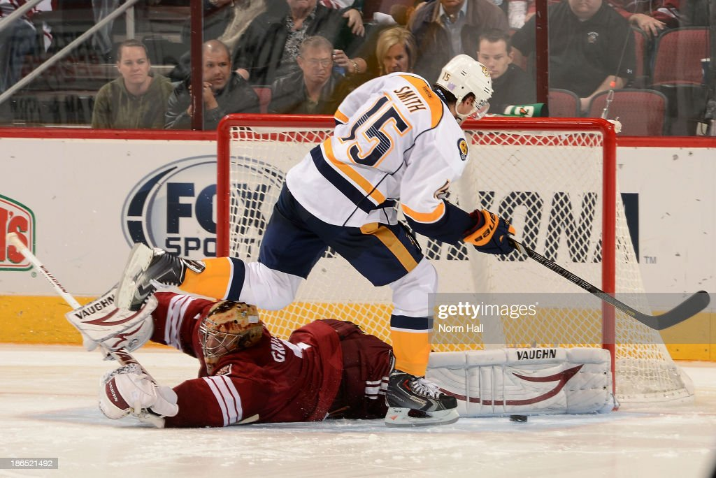 Goalie <a gi-track='captionPersonalityLinkClicked' href=/galleries/search?phrase=Thomas+Greiss&family=editorial&specificpeople=695275 ng-click='$event.stopPropagation()'>Thomas Greiss</a> #1 of the Phoenix Coyotes makes a save on the shot by Craig Smith #15 of the Nashville Predators during an overtime shootout at Jobing.com Arena on October 31, 2013 in Glendale, Arizona. The Coyotes won the game 5-4.