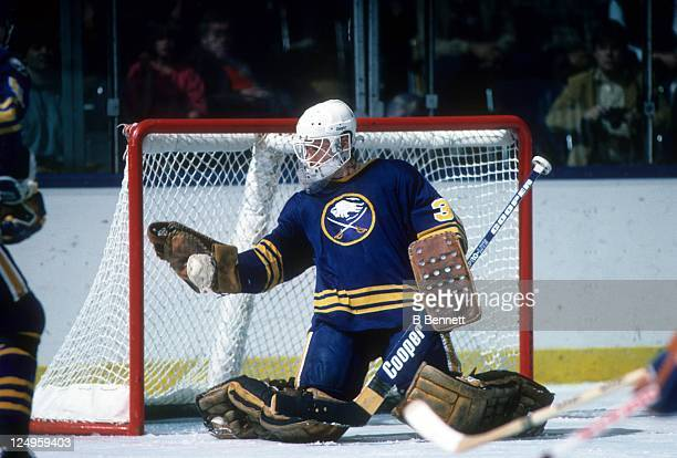 Goalie Tom Barrasso of the Buffalo Sabres makes the glove save during an NHL preseason game against the New York Islanders in October 1984 at the...