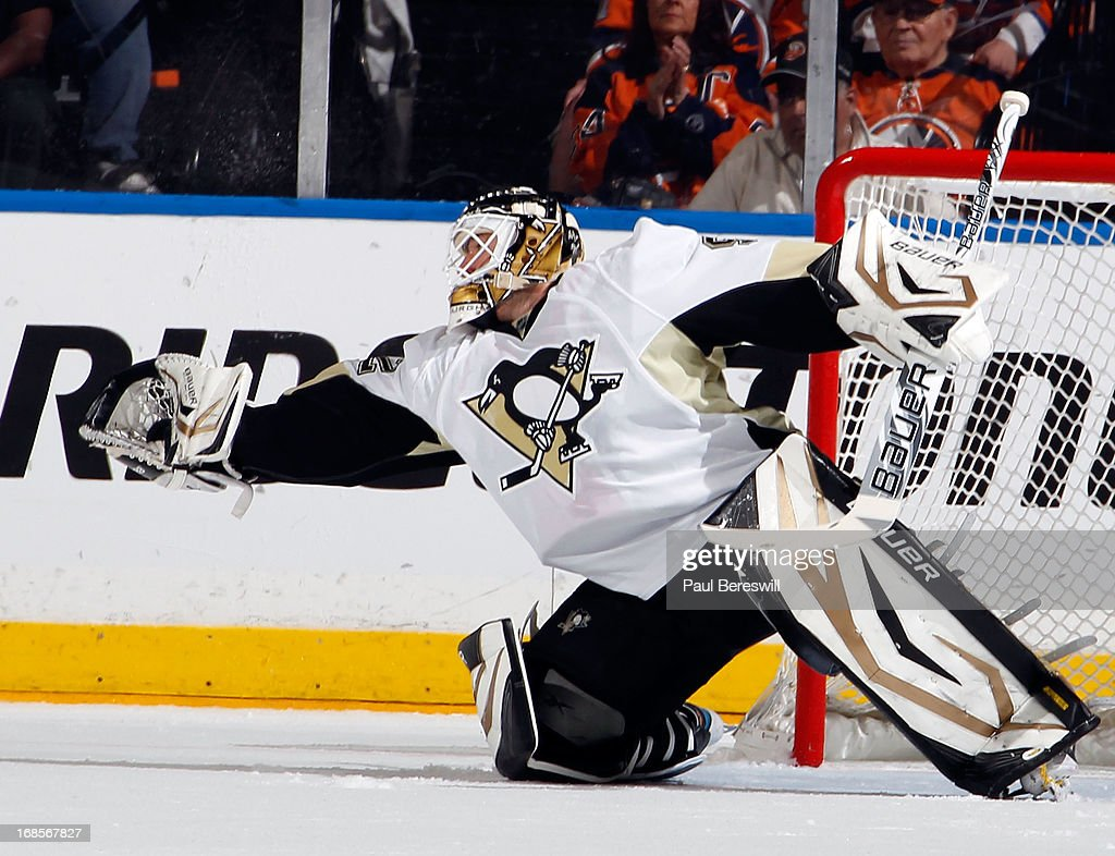 Goalie Tomas Vokoun #92 of the Pittsburgh Penguins makes a glove stop of the puck against the New York Islanders during the first period in Game Six of the Eastern Conference Quarterfinals during the 2013 NHL Stanley Cup Playoffs at Nassau Veterans Memorial Coliseum on May 11, 2013 in Uniondale, New York.