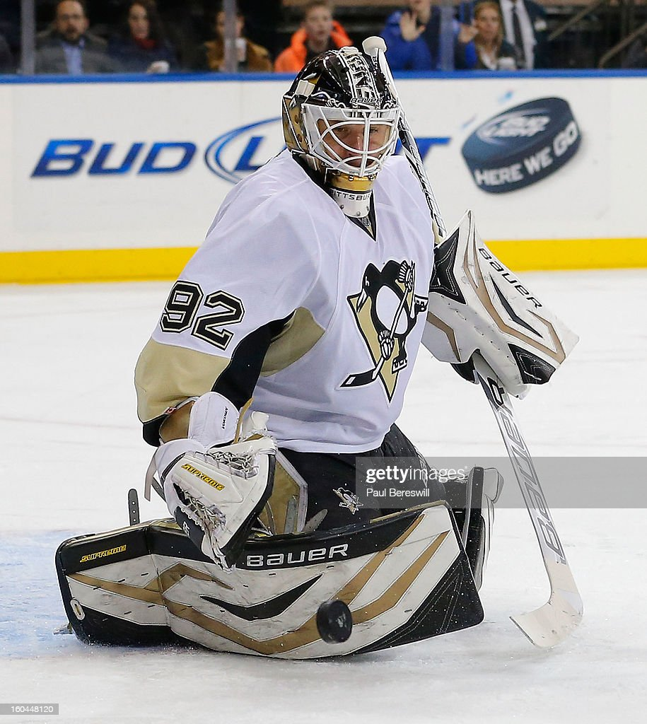 Goalie <a gi-track='captionPersonalityLinkClicked' href=/galleries/search?phrase=Tomas+Vokoun&family=editorial&specificpeople=202179 ng-click='$event.stopPropagation()'>Tomas Vokoun</a> #92 of the Pittsburgh Penguins stops a shot by the New York Rangers in the second period of an NHL hockey game at Madison Square Garden on January 31, 2013 in New York City.