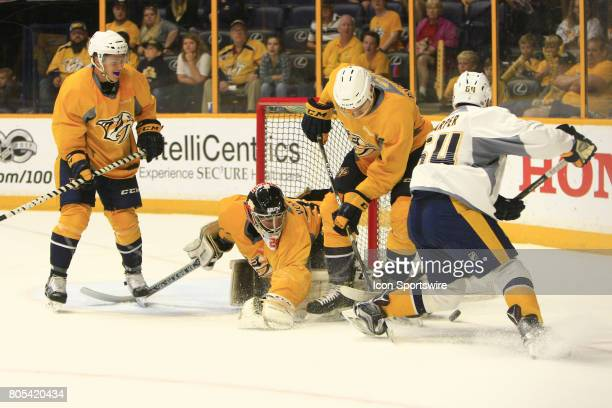 Goalie Tomas Vomacha and Jacob Paquette battle for the puck with Patrick Harper during the 2017 Nashville Predators Future Stars game held on June 30...