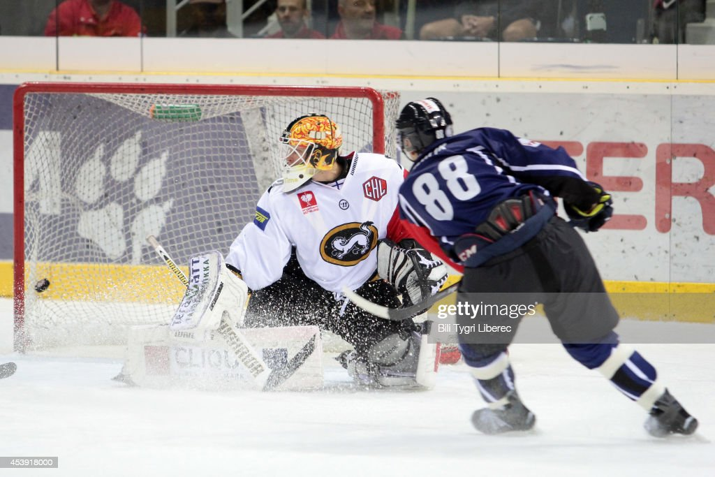 Goalie Tomi Karhunen of Karpat Oulu fails to stop a shot and Michal Bulir of Liberec scores a goal during the Champions Hockey League group stage game between Bili Tygri Liberec and Karpat Oulu on August 21, 2014 in Liberec, Czech Republic.