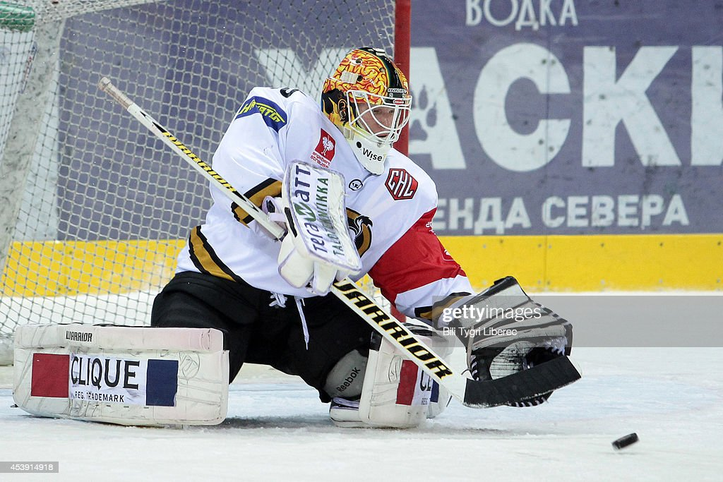 Goalie TOmi Karhunen of Karpat Oulu saves the puck during the Champions Hockey League group stage game between Bili Tygri Liberec and Karpat Oulu on August 21, 2014 in Liberec, Czech Republic.