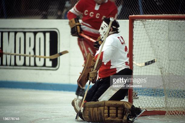 Goalie Tony Esposito of Canada looks to make a save during the game against the Soviet Union in the 1972 Summit Series at the Luzhniki Ice Palace in...