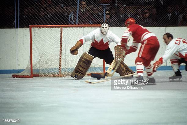 Goalie Tony Esposito of Canada looks to make the save on Vladimir Vikulov of the Soviet Union as Bill White looks to help on defense during the 1972...
