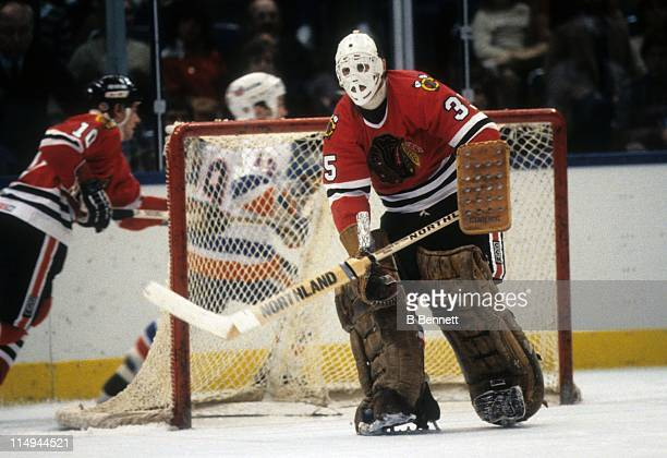 Goalie Tony Esposito of the Chicago Blackhawks defends the net during an NHL game against the New York Islanders circa 1982 at the Nassau Coliseum in...