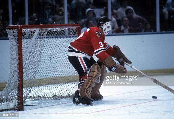 Goalie Tony Esposito of the Chicago Blackhawks goes for the puck during an NHL game circa 1972