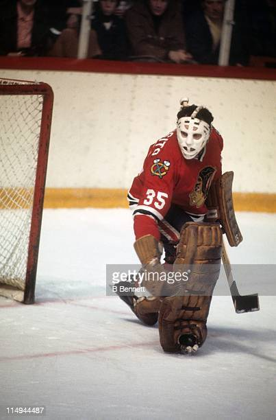 Goalie Tony Esposito of the Chicago Blackhawks looks to make the save during an NHL game circa 1976