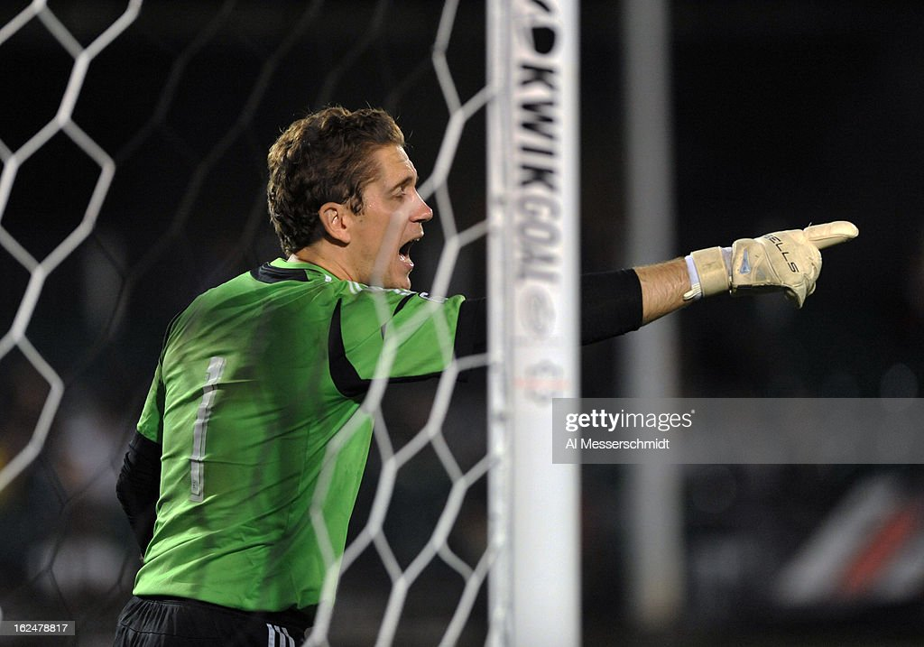 Goalie <a gi-track='captionPersonalityLinkClicked' href=/galleries/search?phrase=Troy+Perkins&family=editorial&specificpeople=596206 ng-click='$event.stopPropagation()'>Troy Perkins</a> #1 of the Montreal Impact directs play before a penalty kick against the Columbus Crew in the final round of the Disney Pro Soccer Classic on February 23, 2013 at the ESPN Wide World of Sports Complex in Orlando, Florida.