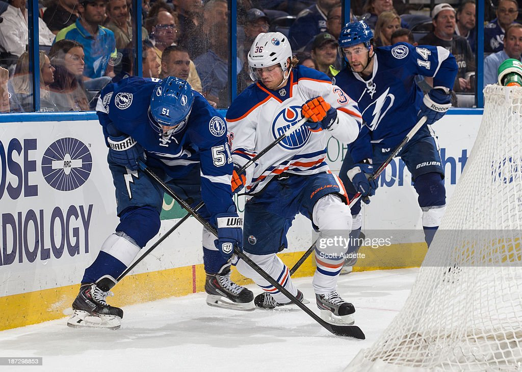 Goalie <a gi-track='captionPersonalityLinkClicked' href=/galleries/search?phrase=Valtteri+Filppula&family=editorial&specificpeople=2234404 ng-click='$event.stopPropagation()'>Valtteri Filppula</a> #51 of the Tampa Bay Lightning battles against <a gi-track='captionPersonalityLinkClicked' href=/galleries/search?phrase=Philip+Larsen&family=editorial&specificpeople=5370941 ng-click='$event.stopPropagation()'>Philip Larsen</a> #36 of the Edmonton Oilers during the third period at the Tampa Bay Times Forum on November 7, 2013 in Tampa, Florida.