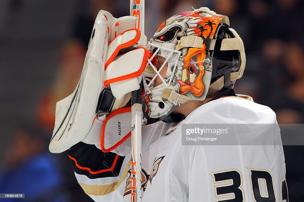 Goalie Viktor Fasth #30 of the Anaheim Ducks adjusts his mask against the Colorado Avalanche at the Pepsi Center on February 6, 2013 in Denver, Colorado. Fasth had 31 saves as the Ducks shut out the Avalanche 3-0.