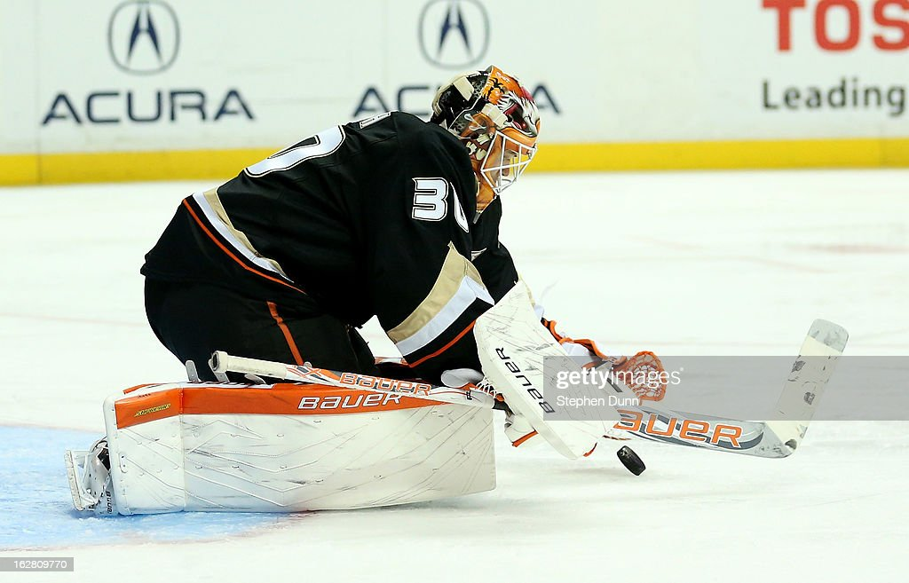 Goalie Viktor Fasth #30 of the Anaheim Ducks covers the puck against the Nashville Predators at Honda Center on February 27, 2013 in Anaheim, California.