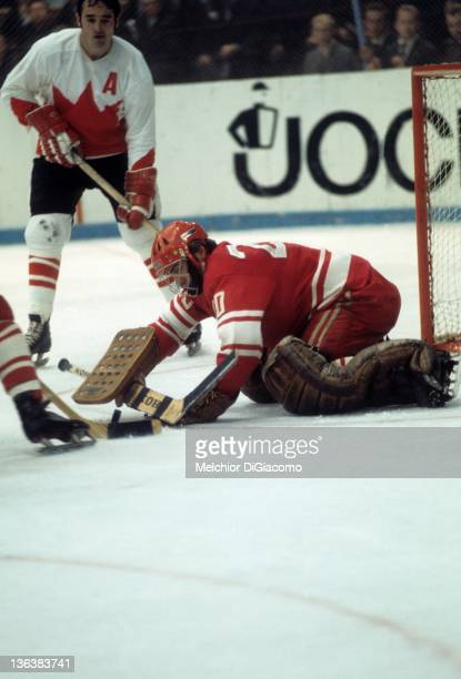 Goalie Vladislav Tretiak covers the puck as Frank Mahovlich of Canada looks for the rebound during the 1972 Summit Series at the Luzhniki Ice Palace...