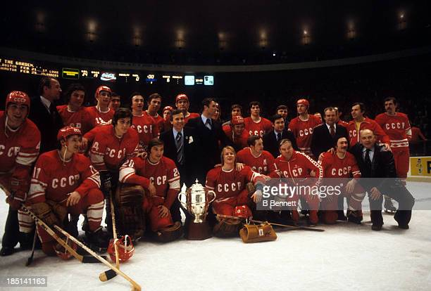 Goalie Vladislav Tretiak head coach Viktor Tikhonov and goalie Vladimir Myshkin of the USSR surround the Challenge Cup after Game 3 of the 1979...