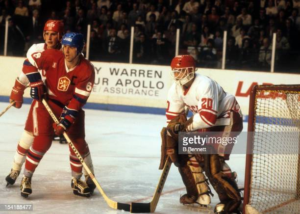Goalie Vladislav Tretiak of the Soviet Union defends the net as teammate Alexei Kasatonov defends against Milan Novy of Czechoslovakia during the...