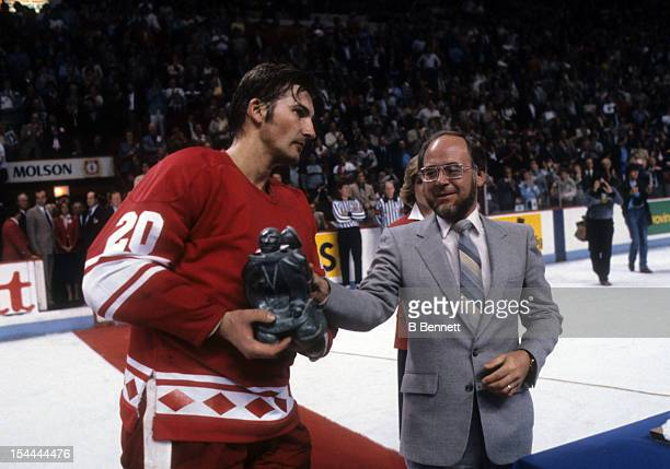 Goalie Vladislav Tretiak of the Soviet Union is given the MVP Trophy by Ron Adlam president of Standard Brands after defeating Canada during the 1981...