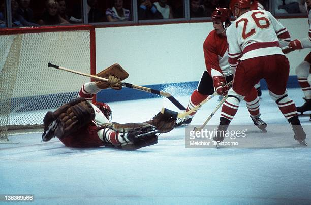 Goalie Vladislav Tretiak of the Soviet Union looks to make the save on Paul Henderson of Canada as Yevgeny Poladiev helps on defense during Game 1 of...