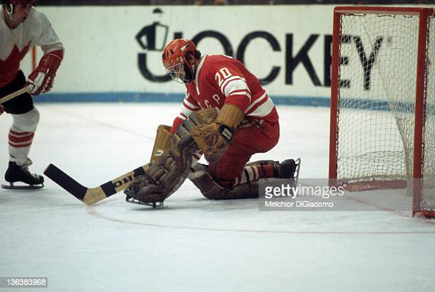 Goalie Vladislav Tretiak of the Soviet Union makes the save as Paul Henderson of Canada looks for the rebound during the 1972 Summit Series at the...