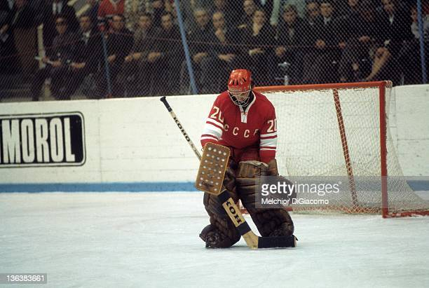 Goalie Vladislav Tretiak of the Soviet Union makes the save during the game against Canada in the 1972 Summit Series at the Luzhniki Ice Palace in...