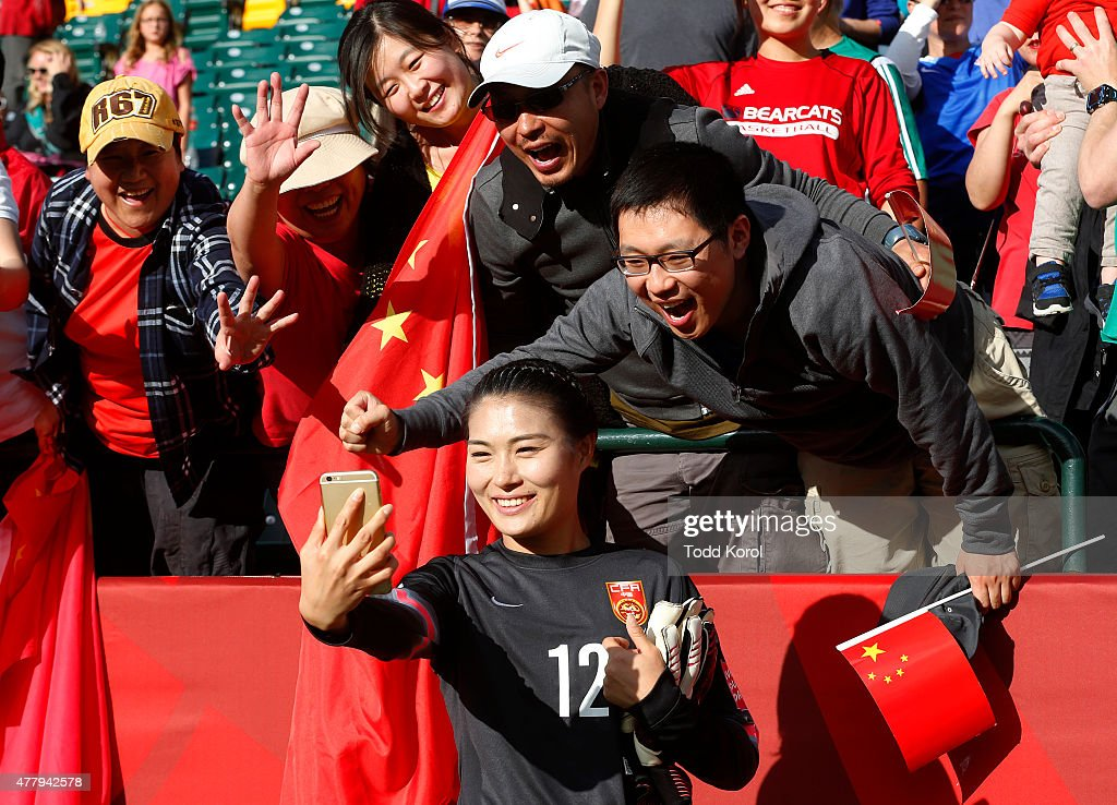 Goalie Wang Fei of China takes a selfie with fans after their victory over Cameroon during the FIFA Women's World Cup Canada Round 16 match between...