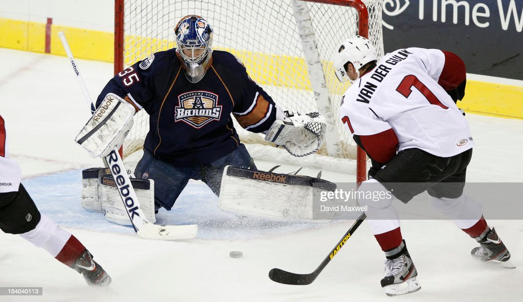 Goalie <a gi-track='captionPersonalityLinkClicked' href=/galleries/search?phrase=Yann+Danis&family=editorial&specificpeople=718375 ng-click='$event.stopPropagation()'>Yann Danis</a> #35 of the Oklahoma City Barons defends the shot attempt by David van der Gulik #7 of the Lake Erie Monsters during their game on October 12, 2012 at Quicken Loans Arena in Cleveland, Ohio. The Monsters defeated the Barons 2-1.