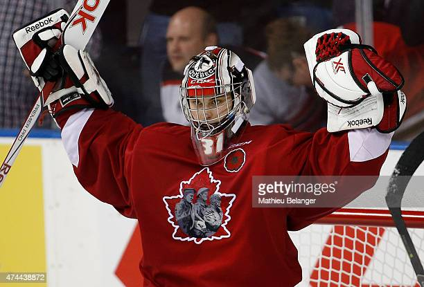 Goalie Zachary Fucale of the Quebec Remparts celebrates after his team's victory against the Kelowna Rockets in Game One of the 2015 Memorial Cup at...
