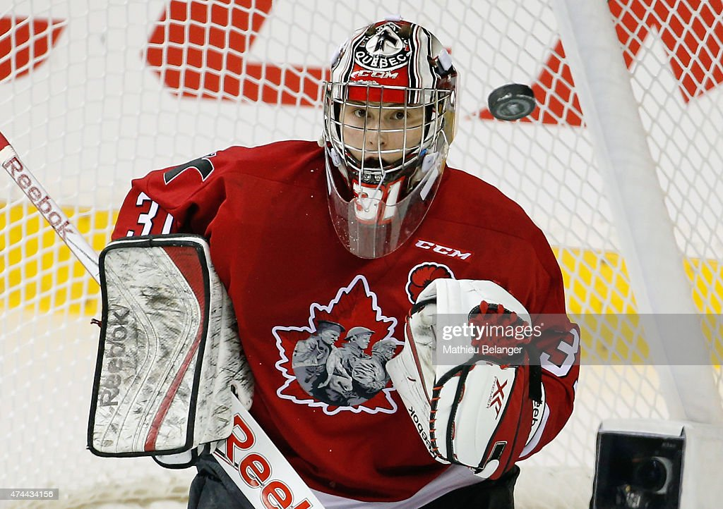 Goalie <a gi-track='captionPersonalityLinkClicked' href=/galleries/search?phrase=Zachary+Fucale&family=editorial&specificpeople=9959699 ng-click='$event.stopPropagation()'>Zachary Fucale</a> #31 of the Quebec Remparts eyes the puck during Game One of the 2015 Memorial Cup against the Kelowna Rockets at the Pepsi Coliseum on May 22, 2015 in Quebec City, Quebec, Canada.