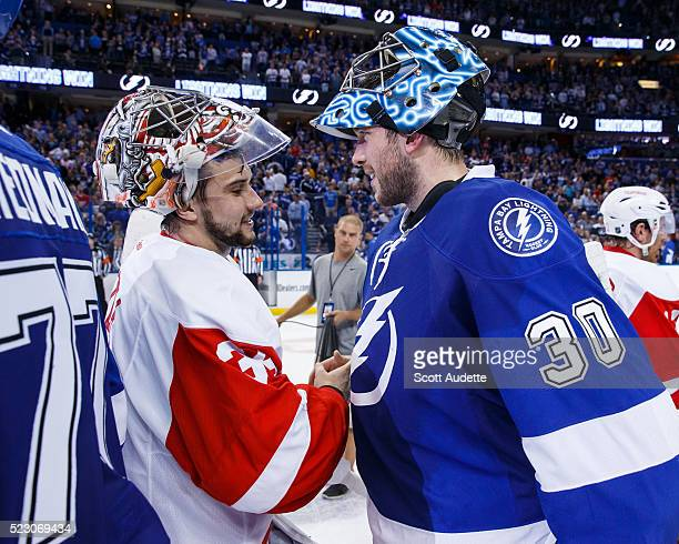 Goalies Ben Bishop of the Tampa Bay Lightning shakes the hand of Petr Mrazek of the Detroit Red Wings after the series win in Game Five of the...