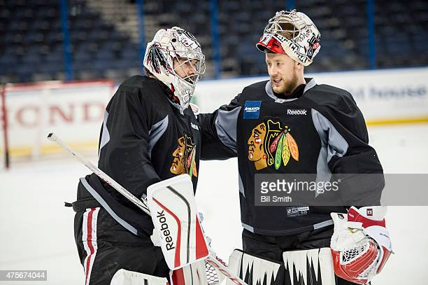 Goalies Corey Crawford and Antti Raanta of the Chicago Blackhawks talk during a practice for the 2015 NHL Stanley Cup Final at Amalie Arena on June 2...