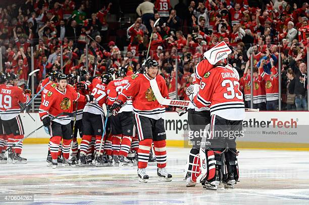 Goalies Corey Crawford and Scott Darling of the Chicago Blackhawks hug after defeating the Nashville Predators 32 in triple overtime in which Darling...