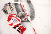 A goalies equipment is pictured on the ice after the International Ice Hockey Series between the United States and Canada at Allphones Arena on July...