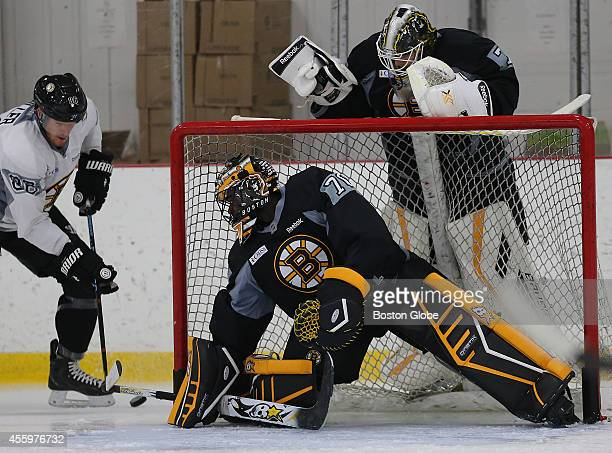 Goalies Malcolm Subban and above him goalie Niklas Svedberg with Kevan Miller on the left at Bruins training camp at Ristuccia Arena in Wilmington