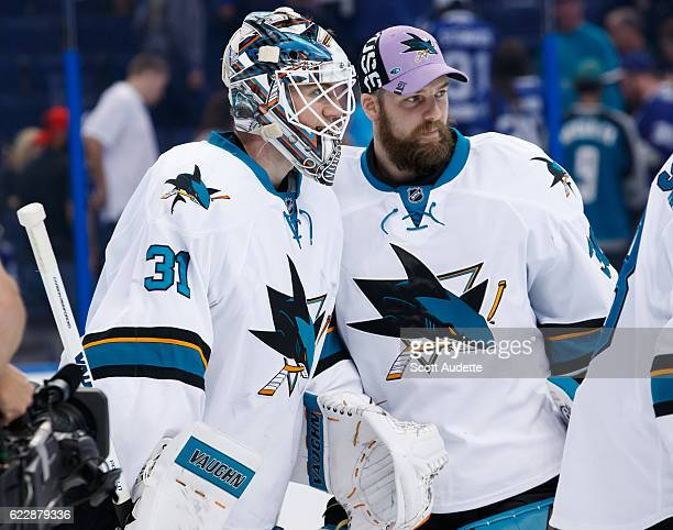 Goalies Martin Jones and Aaron Dell of the San Jose Sharks celebrate the win against the Tampa Bay Lightning at Amalie Arena on November 12 2016 in...