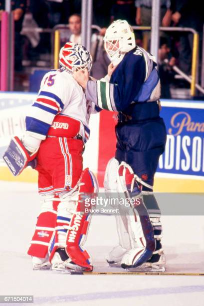 Goalies Mike Richter of the New York Rangers and Sean Burke of the Hartford Whalers act like they are fighting before an NHL game on April 5 1993 at...