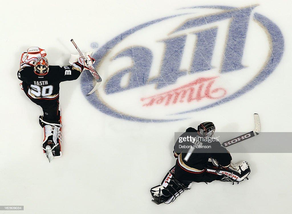 Goalies Viktor Fasth #30 and Jonas Hiller #1 of the Anaheim Ducks warmup before the game against the Nashville Predators on February 27, 2013 at Honda Center in Anaheim, California.