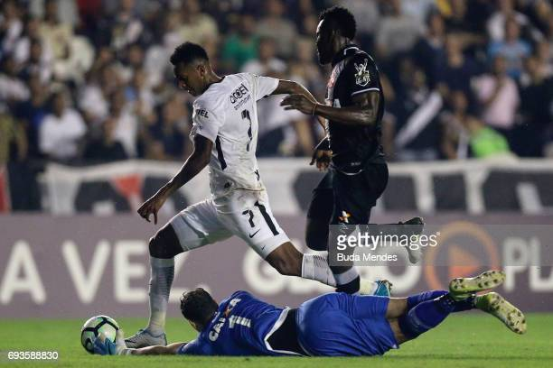 Goalkeeeper Martin Silva and Paulao of Vasco da Gama struggles for the ball with Jo of Corinthians during a match between Vasco da Gama and...