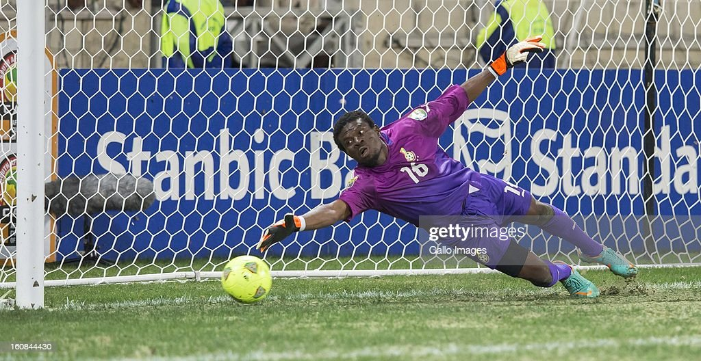 Goalkeeper Abul-Fatawu Dauda of Ghana fails to save a penalty during the 2013 Orange African Cup of Nations 2nd Semi Final match between Burkina Faso and Ghana at Mbombela Stadium on February 06, 2013 in Nelspruit, South Africa.