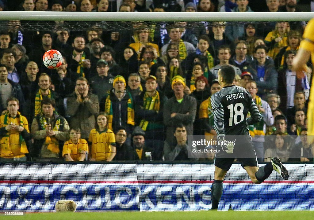 Goalkeeper <a gi-track='captionPersonalityLinkClicked' href=/galleries/search?phrase=Adam+Federici&family=editorial&specificpeople=886953 ng-click='$event.stopPropagation()'>Adam Federici</a> of Australia watches as the ball goes over his head and into the goal after Giannis Maniatis of Greece kicked a goal from half way during the International Friendly match between the Australian Socceroos and Greece at Etihad Stadium on June 7, 2016 in Melbourne, Australia.