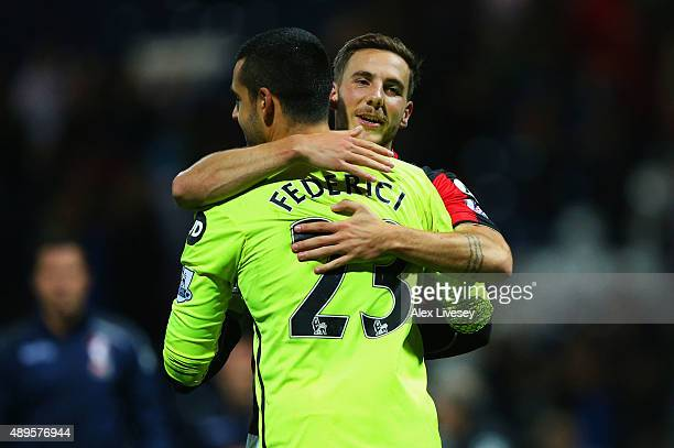 Goalkeeper Adam Federici of Bournemouth celebrates with team mate Dan Gosling of Bournemouth as he saves the decisive kick in the penalty shoot out...