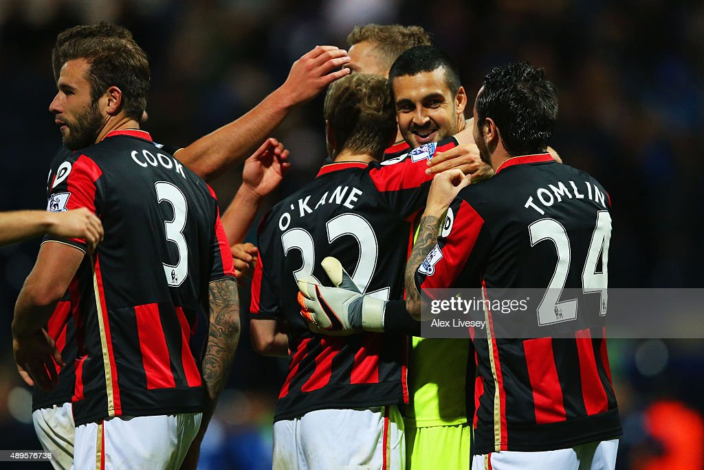 Goalkeeper <a gi-track='captionPersonalityLinkClicked' href=/galleries/search?phrase=Adam+Federici&family=editorial&specificpeople=886953 ng-click='$event.stopPropagation()'>Adam Federici</a> of Bournemouth (2R) celebrates with team mates as he saves the decisive kick in the penalty shoot out during the Capital One Cup third round match between Preston North End and AFC Bournemouth at Deepdale on September 22, 2015 in Preston, England. AFC Bournemouth won 3-2 on penalties.