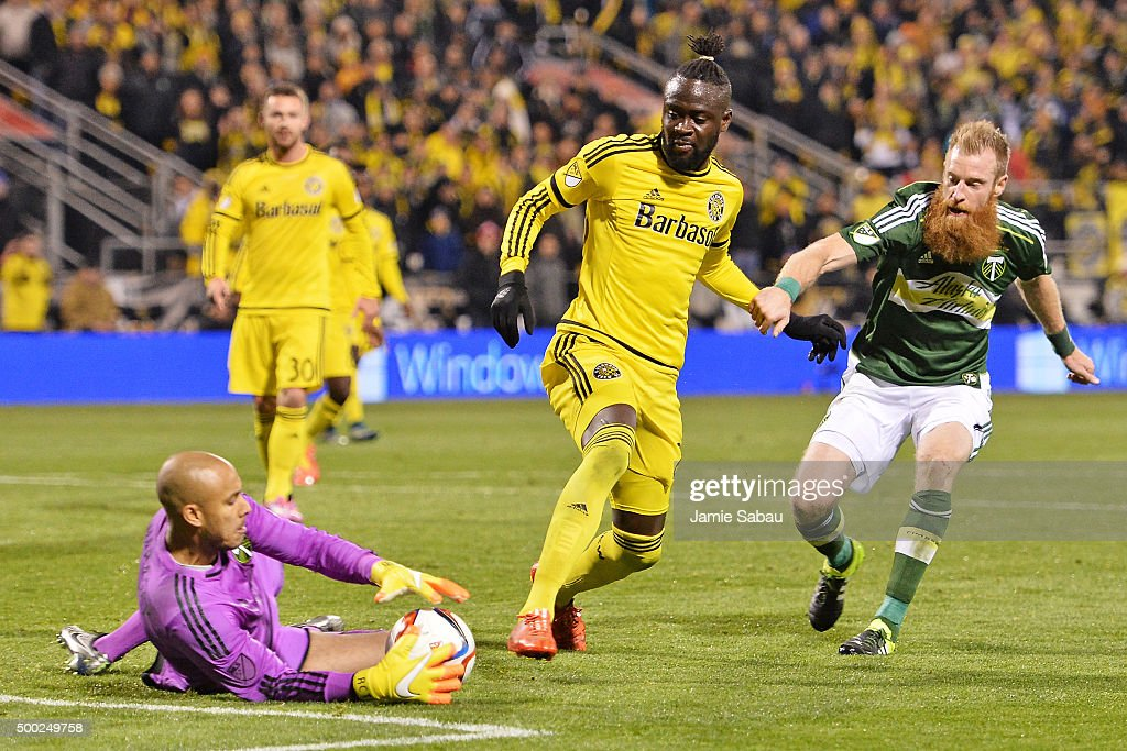 Goalkeeper Adam Kwarasey #12 of the Portland Timbers slides in to take control of the ball as Kei Kamara #23 of the Columbus Crew SC and Nat Borchers #7 of the Portland Timbers move in in the second half on December 6, 2015 at MAPFRE Stadium in Columbus, Ohio. Portland defeated Columbus Crew SC 2-1 to claim the MLS Cup title.