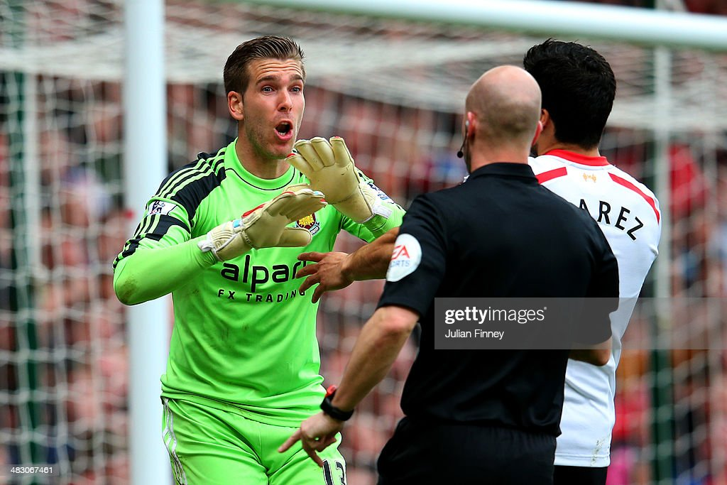 Goalkeeper Adrian of West Ham remonstrates with referee Anthony Taylor after he concedes a penalty for bringing down Jon Flanagan of Liverpool during the Barclays Premier League match between West Ham United and Liverpool at Boleyn Ground on April 6, 2014 in London, England.