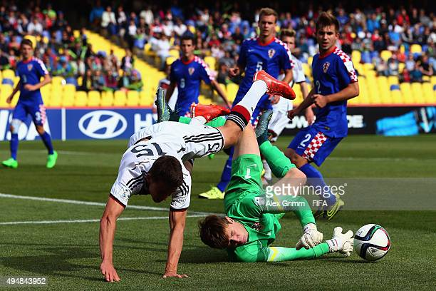 Goalkeeper Adrian Semper of Croatia makes a save against Salih Oezcan of Germany during the FIFA U17 World Cup Chile 2015 Round of 16 match between...
