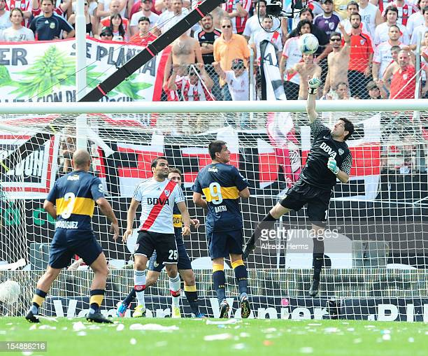 Goalkeeper Agustin Orion of Boca Juniors jumps for the ball during a match between Boca Juniors and River Plate as part of the Torneo Inicial 2012 at...